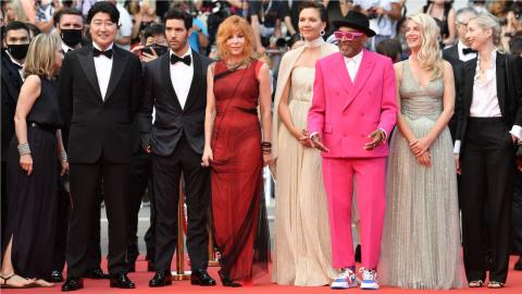 The opening night of the 2021 Cannes film festival: Spike Lee, in a pink suit, surrounded by his jury