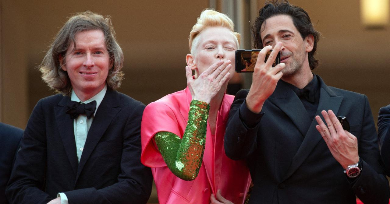 Cannes 2021: Adrien Brody and Tilda Swinton take a selfie, alongside Wes Anderson as they climb the steps of The French Dispatch